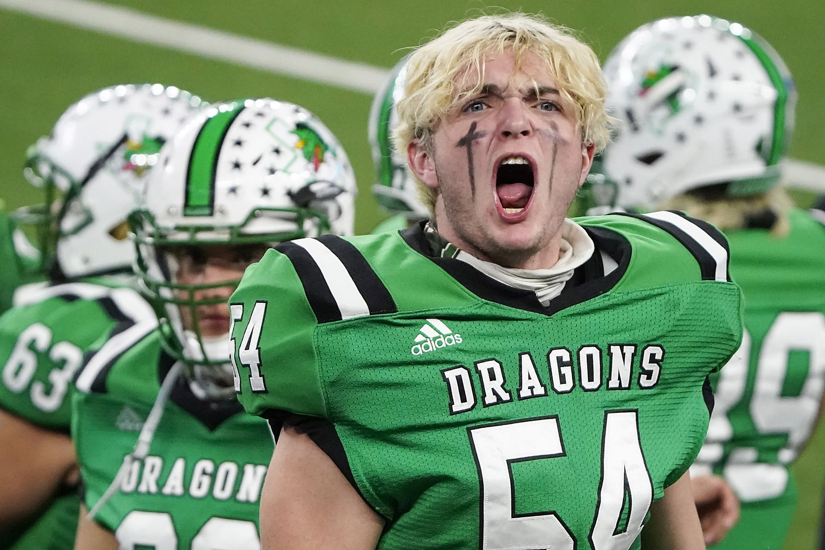 Southlake Carroll defensive lineman Jim Cates (54) yells to try and fire up the crowd during the third quarter of the Class 6A Division I state football championship game against Austin Westlake at AT&T Stadium on Saturday, Jan. 16, 2021, in Arlington, Texas.