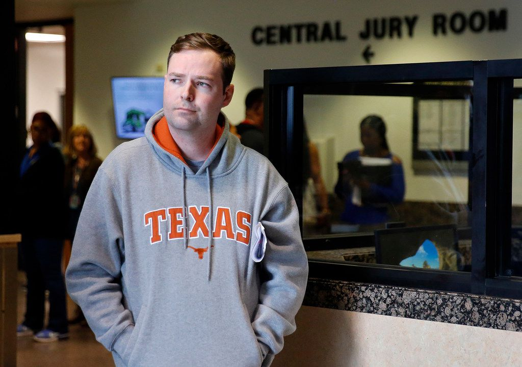 Austin Shuffield, 30, as he waits for a ride after at the Frank Crowley Criminal Courts Building he was released on a $1,000 bail, Friday. Shuffield was booked into the Dallas County Jail about 8:15 a.m. Friday on an unlicensed-weapon charge, one of four misdemeanors he faces. Police have also referred a felony assault case to the grand jury after he was accused of repeatedly punching a woman. The incident was captured on video.