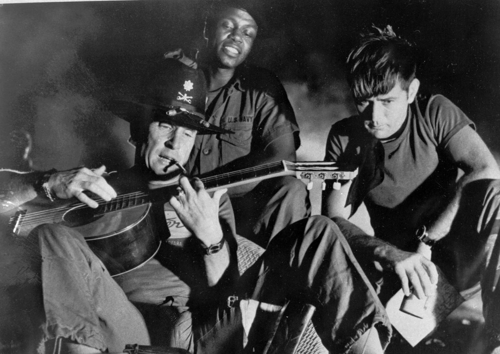 "In this undated file photo, from left, Robert Duvall as Lt. Col. Kilgore, Albert Hall as Chief and Martin Sheen as Capt. Willard, are shown in the film ""Apocalypse Now,"" a United Artists release. For the first time since, Duvall and Sheen appear in the new movie, ""12 Mighty Orphans."" (AP Photo/United Artists, File)"