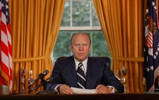"In a file photo President Gerald Ford reads a proclamation in the White House on Sept. 9, 1974 granting former president Richard Nixon ""a full, free and absolute pardon"" for all ""offenses against the United States"" during the period of his presidency."