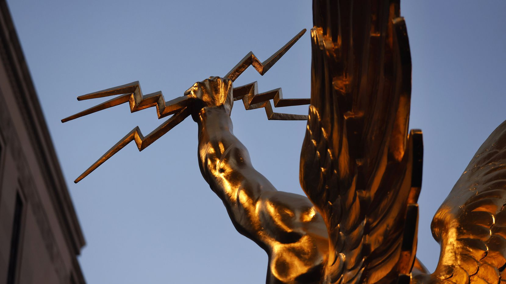 Golden Boy, the Spirit of Communication statue, is pictured in the new AT&T Discovery District in downtown Dallas, Tuesday, April 20, 2021. The statue, originally called Genius of Telegraphy, stood atop AT&T's headquarters in New York City decades ago.