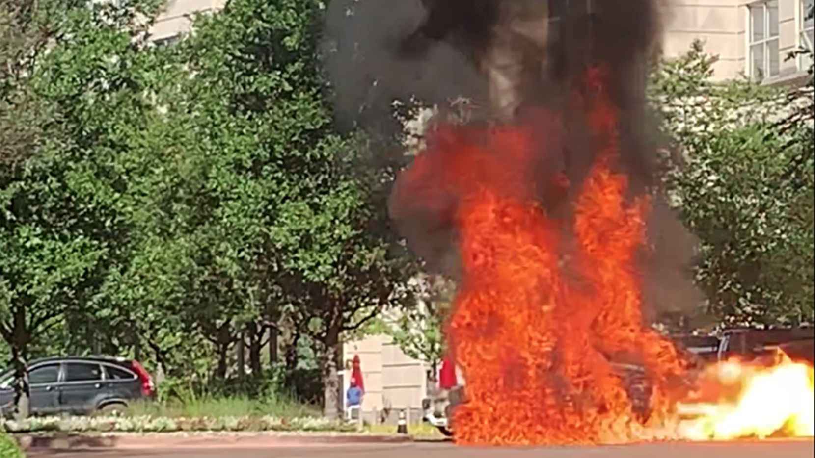 A car caught fire and exploded outside the Crescent complex Thursday in Uptown Dallas.