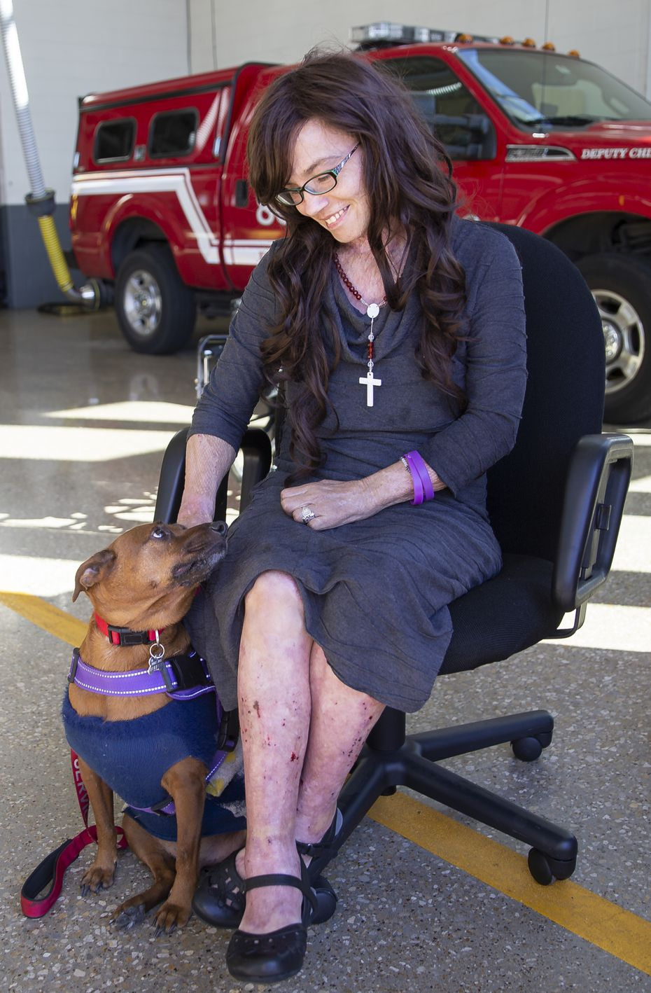 Danyeil Townzen pets her service dog, Cowboy. The pair was reunited after nearly 17 months apart. (Juan Figueroa/ The Dallas Morning News)