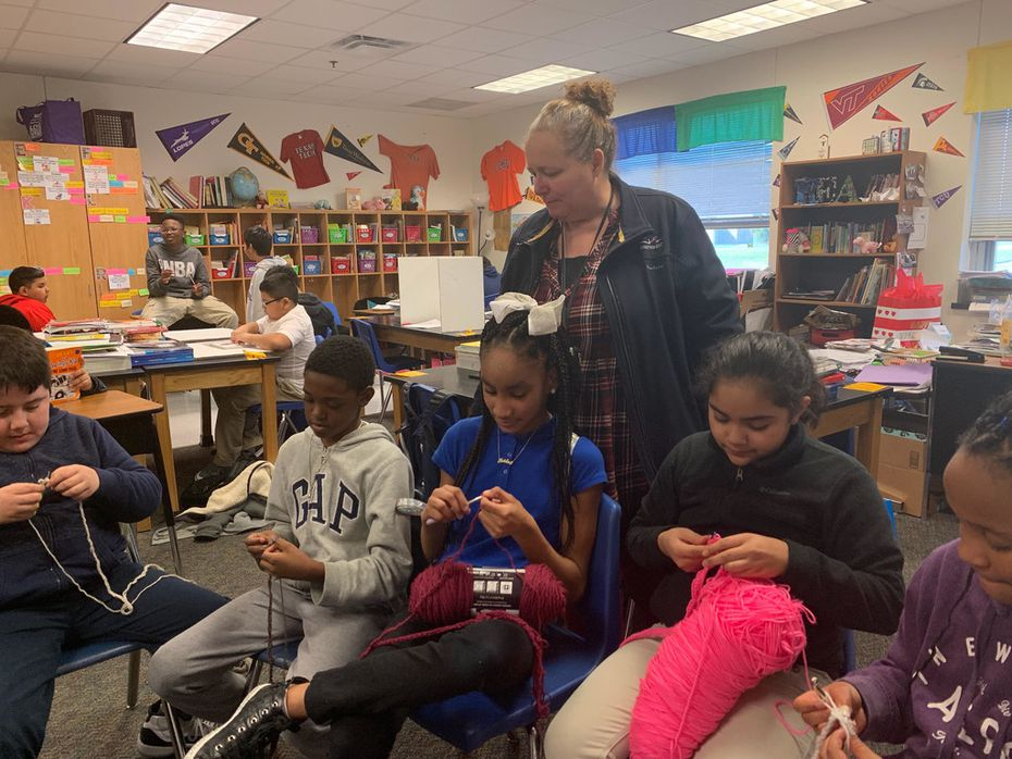 Charlotte Geisler teaches some of her fifth-grade students at Wilmer-Hutchins Elementary School how to crochet. Once a month, Geisler collects the items they create and donates them to local homeless shelters.