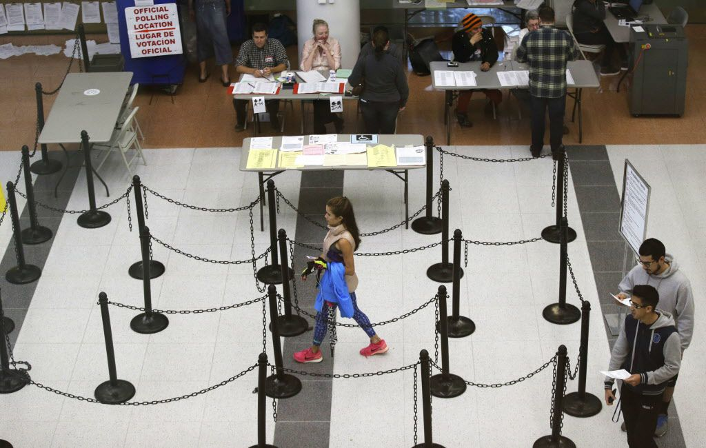 Voters walk through a polling station in Dallas.