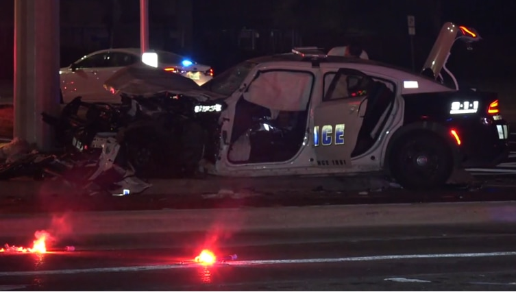 An image from the scene at Webb Chapel Extension and Northwest Highway, where a Dallas police car collided with a pickup early Saturday.