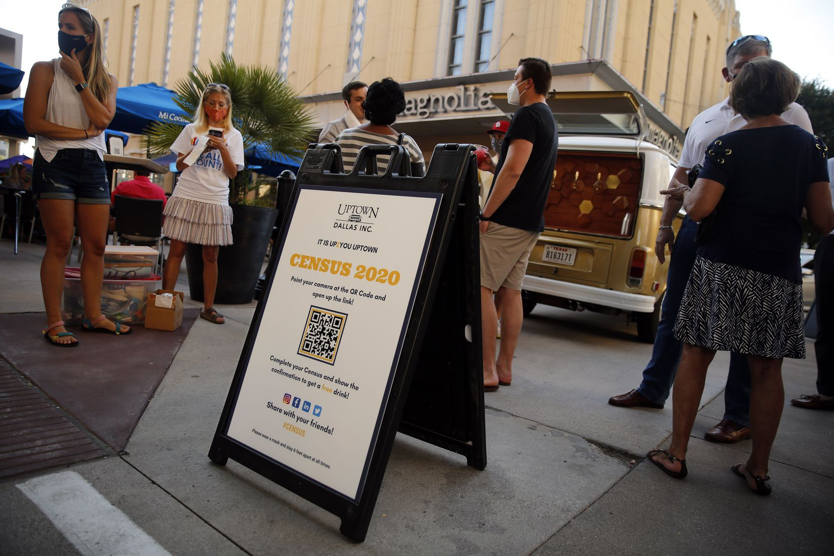 Volunteers with Uptown Dallas encourage people outside Mi Cocina at West Village shopping center to register for Census 2020 in Dallas, Thursday, August 20, 2020. Those who did were given free drinks by Bubble Bus Co., a mobile beverage van.