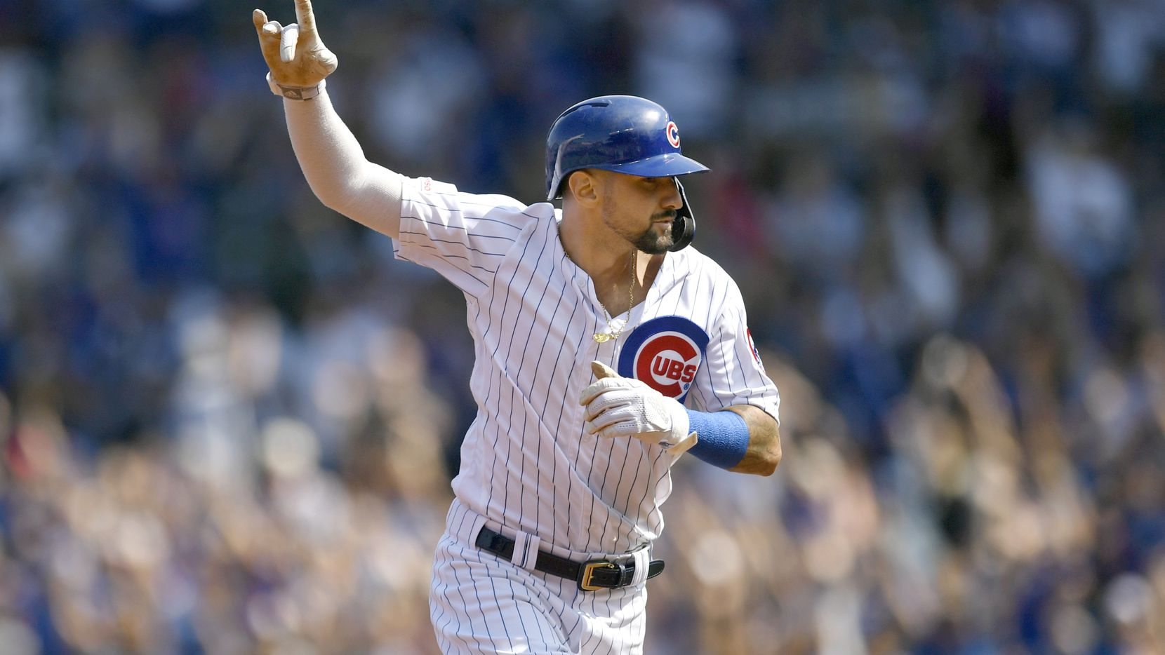 FILE - Chicago Cubs' Nicholas Castellanos celebrates while rounding the bases after Kris Bryant hit a three-run home run during the first inning of a baseball game against the Pittsburgh Pirates Sunday, Sept. 15, 2019, in Chicago. (AP Photo/Paul Beaty)