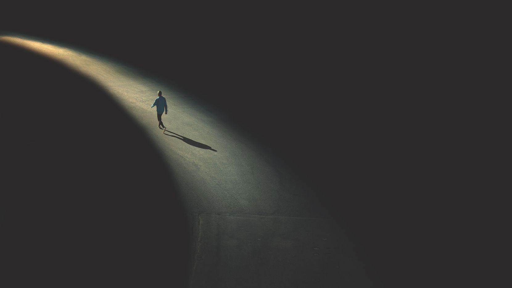 man walking in the night