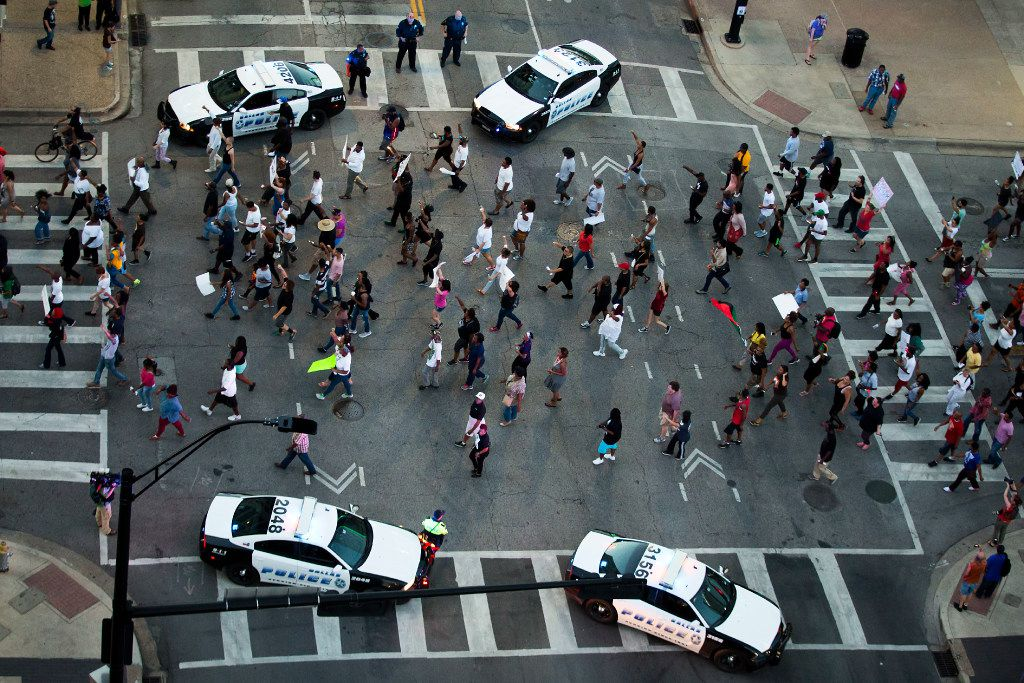 The intersection of Main and Lamar streets in downtown Dallas at the end of the peaceful Black Lives Matter march on July 7. About 15 minutes Šlater, Micah Johnson began his deadly ambush. Officer Patrick Zamarripa, who was killed, can be seen at the bottom of the picture standing by a patrol car. Two of the other slain officers, Senior Cpl. Lorne Ahrens and Officer Michael Krol, are seen in the top of the photo standing in the crosswalk. Ahrens (center) has sunglasses on his head, and Krol is standing beside him.