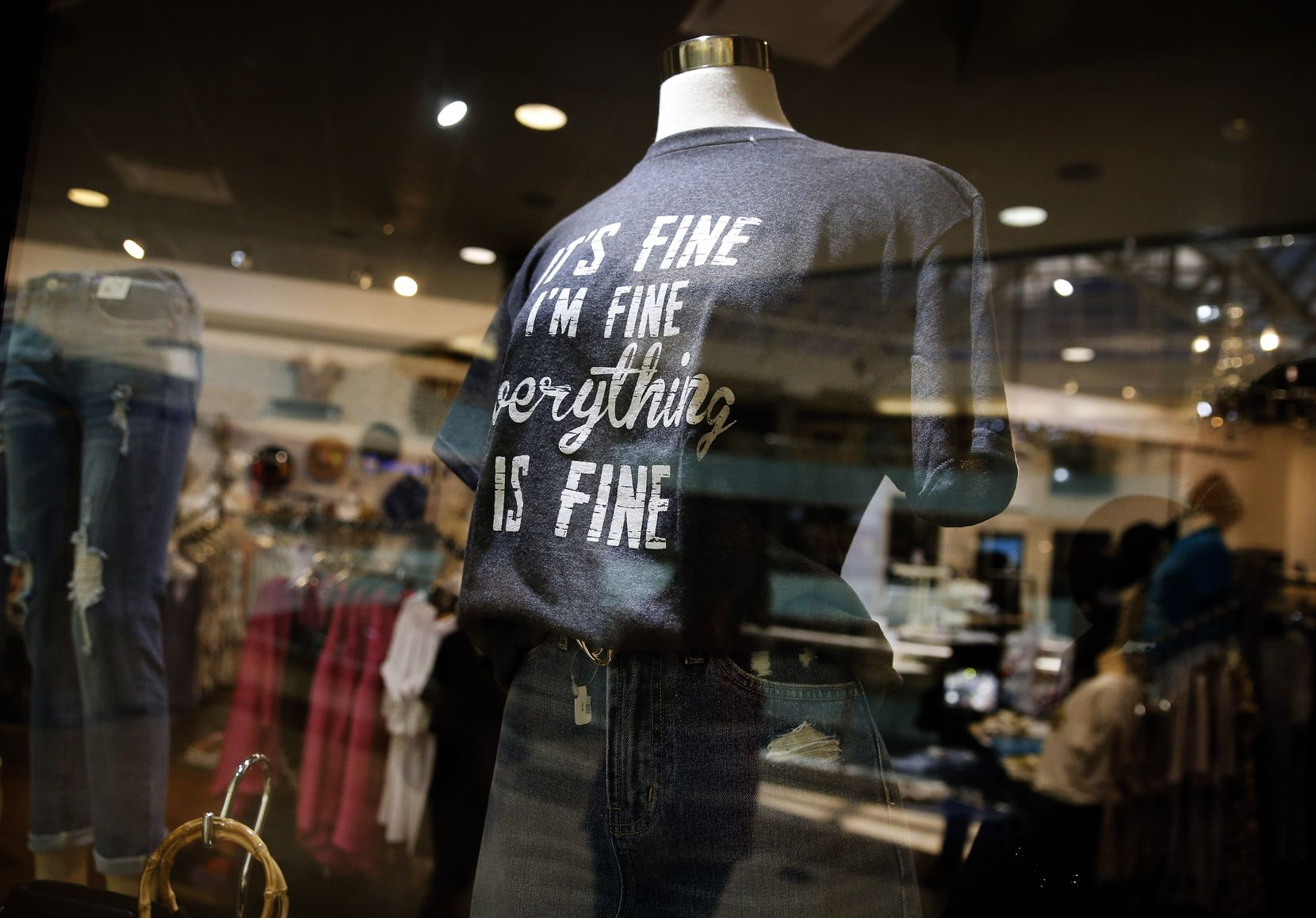 "A T-shirt at Apricot Lane with lettering that reads ""It's Fine, I'm Fine, Everything is Fine"" becomes a sign of the times. Shoppers returned to the Galleria Dallas, Friday, June 5, 2020, after being closed this week in the wake of looting that stemmed from the protests over George Floyd's death while in Minneapolis police custody. It was also closed during the COVID-19 pandemic."