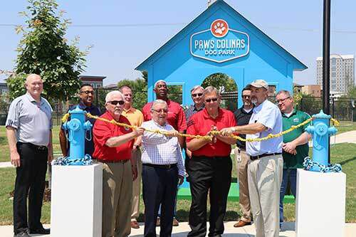Irving Mayor Rick Stopfer cut the ribbon at the opening of Paws Colinas Dog Park recently with leaders from the City of Irving and Las Colinas Association.
