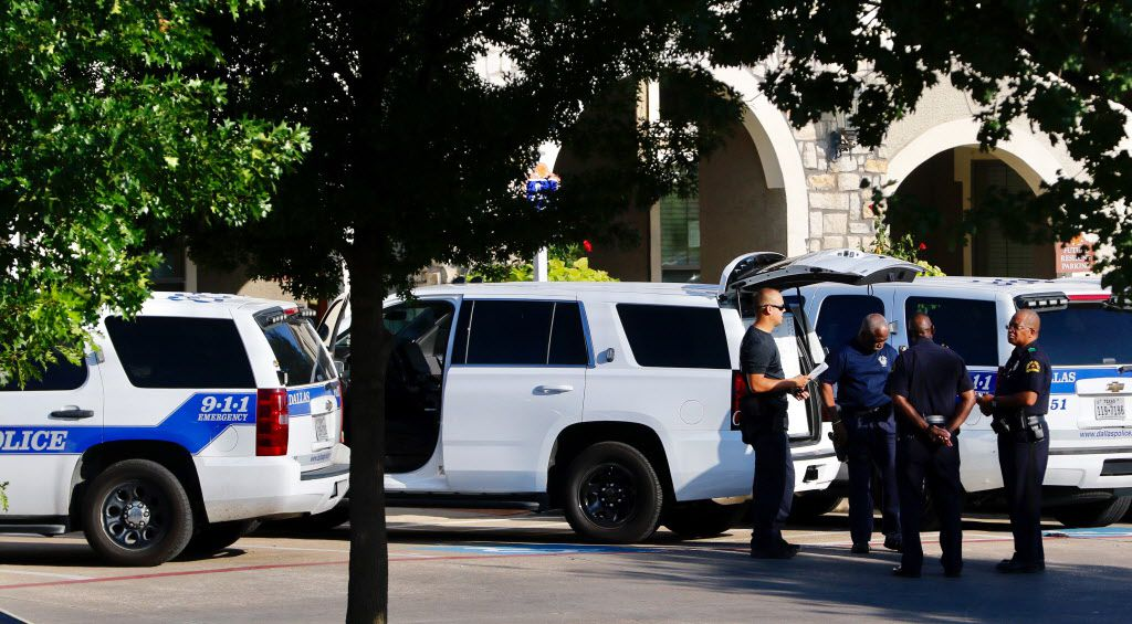 Dallas SWAT responds to a person barricaded in the Rosemont Cedar Crest Apartments in the 3300 block of  Summer Oaks Blvd in Dallas on Thursday.