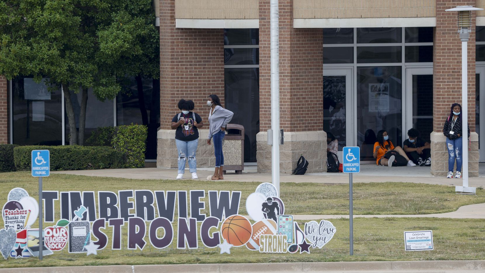 Students from Timberview High School leave campus after class Tuesday in Arlington. Students returned to classes on Tuesday after a shooting on Oct. 6 left four people injured.