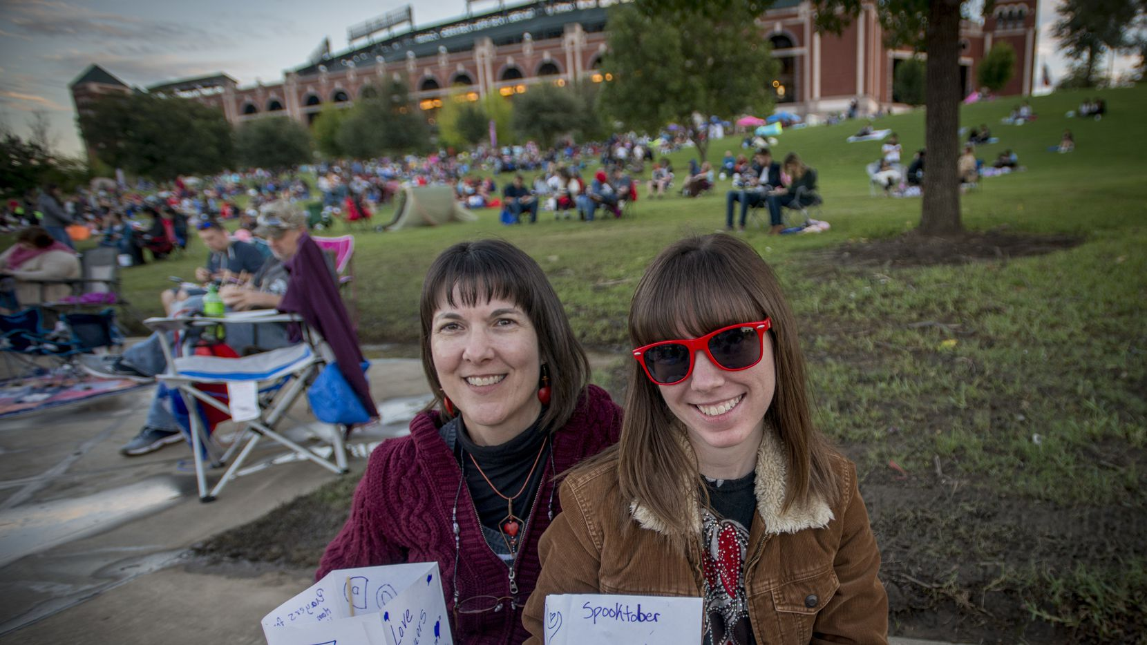 Tracie Matthews, left, and daughter Jordan Matthews with the water lanterns they prepared for the Water Lantern Festival at Mark Holz Lake at Globe Life Park in Arlington, Texas on October 20, 2018. (Robert W. Hart/Special Contributor)