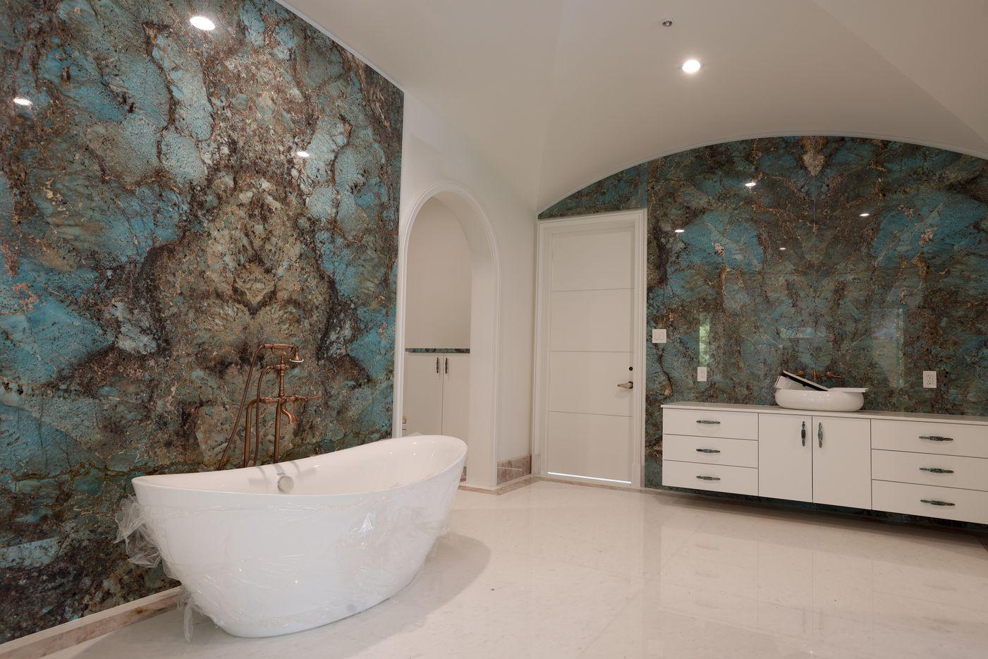 The master bathroom has Amazonite walls and a rose quartz border along the floor.