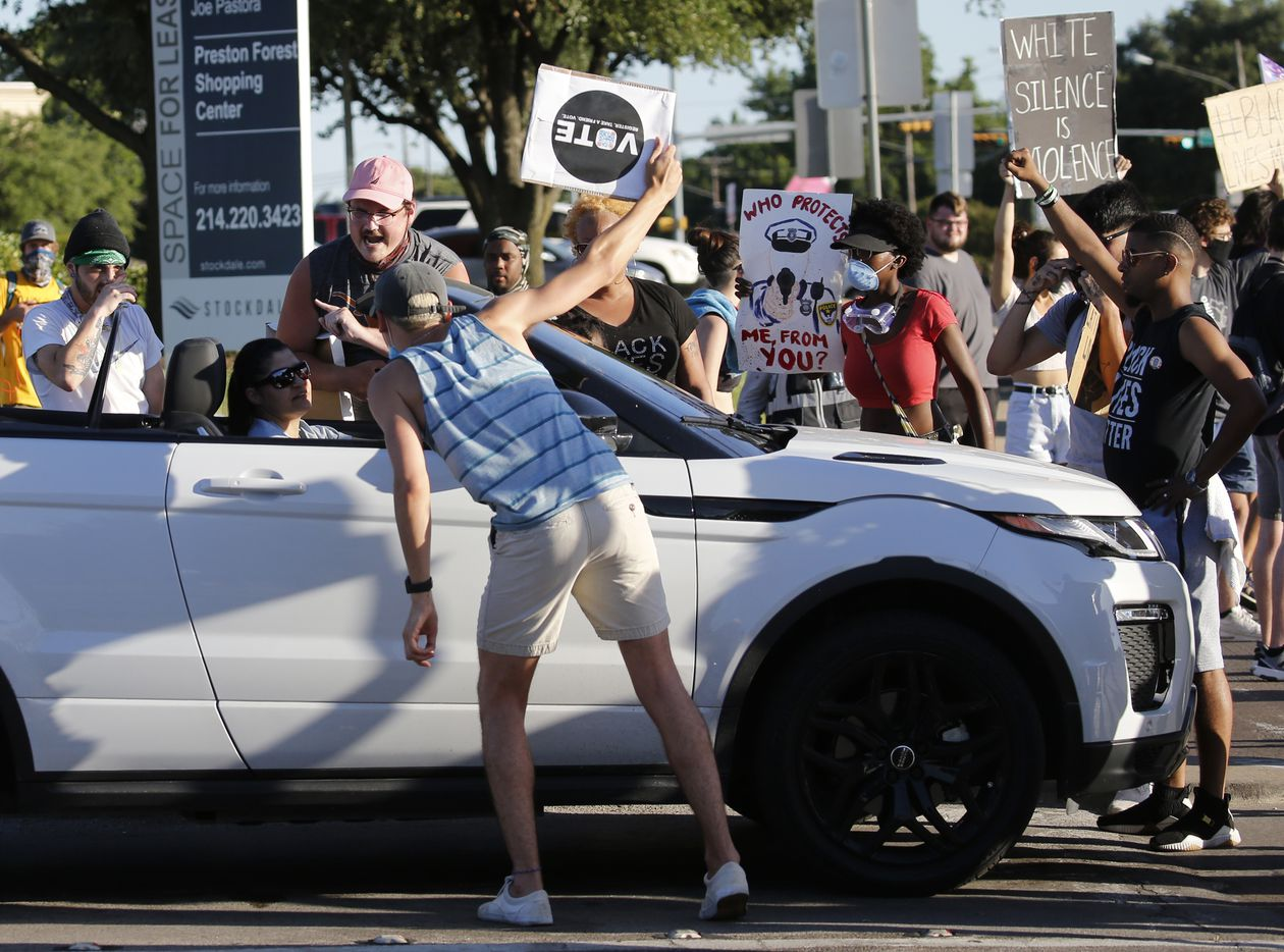 Protesters talk to a driver as they block the intersection of Preston Rd. and Forest Lane in Dallas on Thursday, June 11, 2020. President Donald Trump was in town for multiple events. (Vernon Bryant/The Dallas Morning News)
