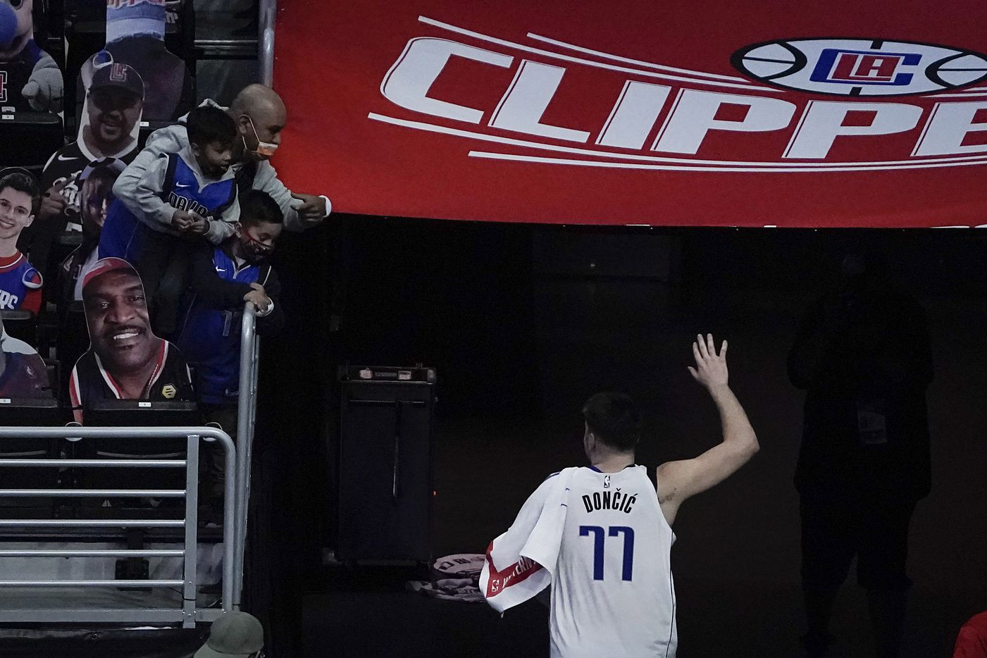 Dallas Mavericks guard Luka Doncic wave to fans as he leaves the court after a 113-103 victory over the LA Clippers in an NBA playoff basketball game at Staples Center on Saturday, May 22, 2021, in Los Angeles.