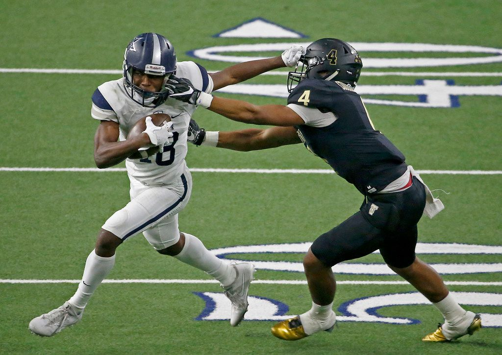 Frisco Lone Star's Marvin Mims (18) tries to get away from The Colony's Jaxon Gibbs (4) after a catch during the third quarter at The Ford Center at The Star in Frisco, Texas, Thursday, Nov. 16, 2017. (Jae S. Lee/The Dallas Morning News)