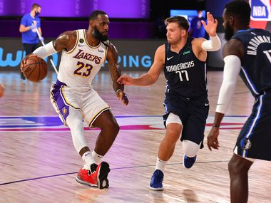 ORLANDO, FL - JULY 23: LeBron James (23) of the Lakers drives to the basket against Luka Doncic (77) of the Mavericks on July 23, 2020, at the Visa Athletic Center at ESPN Wide World of Sports Complex in Orlando, Fla.