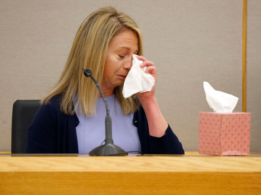 Amber Guyger uses a tissue to wipe her face after breaking into tears during her testimony on the fifth day of her murder trial.