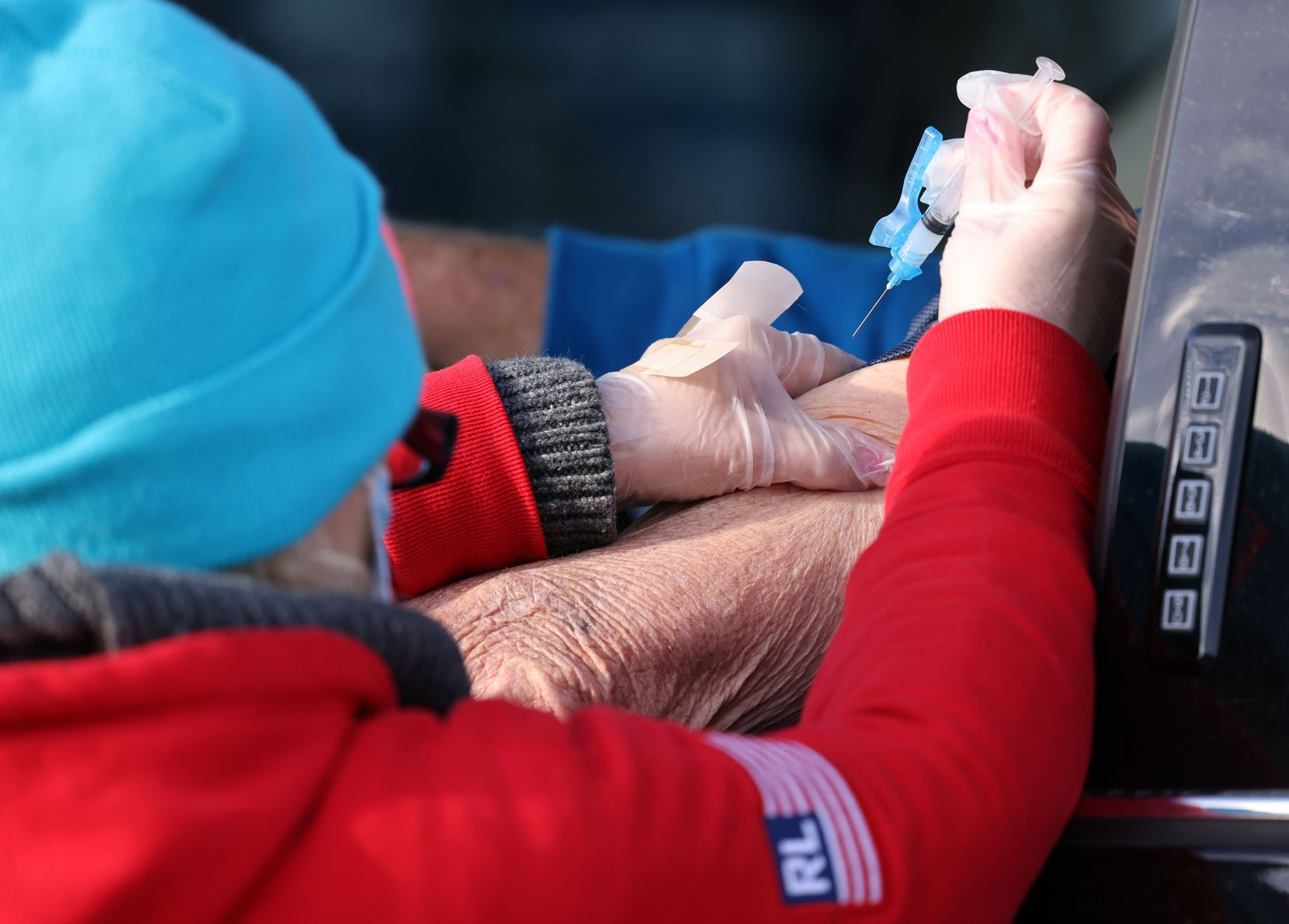 Nurse Penny Mayo administers a COVID-19 vaccination clinic at Texas Motor Speedway.
