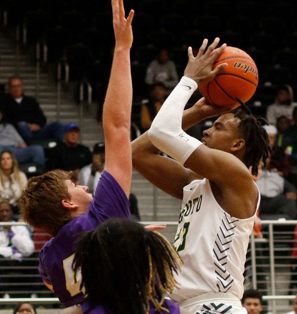 DeSoto post Tavion Carroll (23) shoots over the defense of Richardson forward Gannon Parker (41) during first half action.  The two teams played their Class 6A boys bi-district playoff basketball game at Forney High School in Forney on February 24 2020. (Steve Hamm/Special Contributor).
