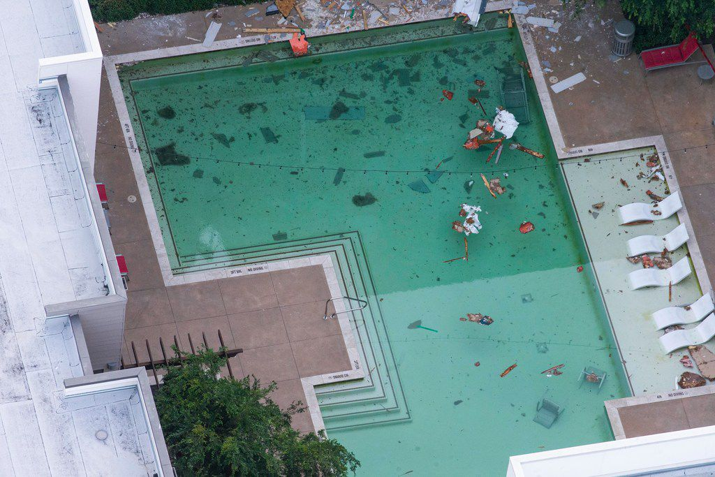 Debris lies in the swimming pool after a tower crane fell from a construction site into Elan City Lights apartments in Dallas.  Kiersten Smith, 29, who lived at the complex, was killed when the crane collapsed.  Five other people were hurt in the collapse, including two who were critically injured.