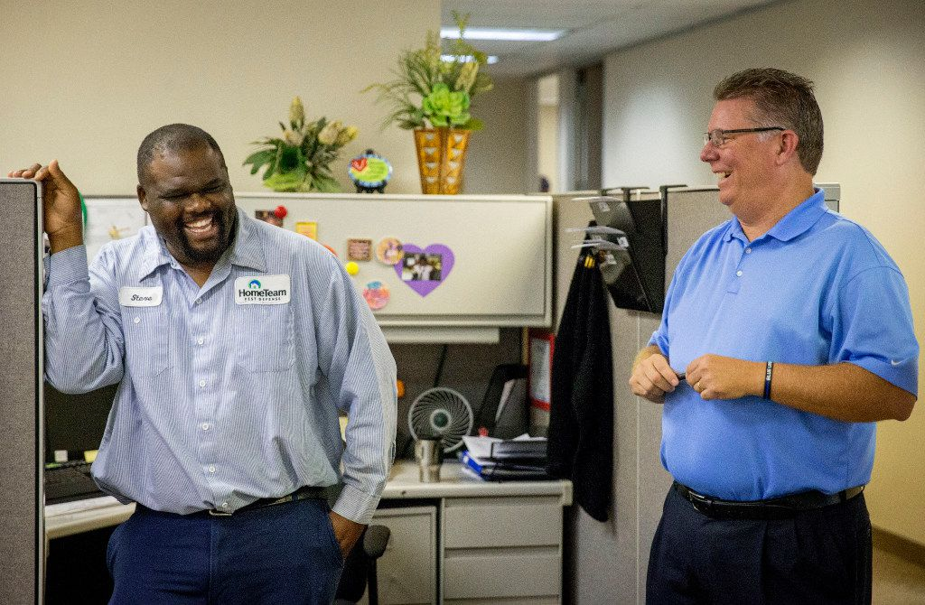 Field supervisor Steve Henderson (left) and Pat Walsh, manager of the HomeTeam Defense West Dallas branch, laugh during a morning meeting.