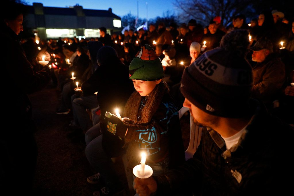 Friends, family, and supporters lit candles near the end of a vigil for slain Richardson police officer David Sherrard outside the Richardson Civic Center in Richardson, Texas, Sunday, February 11, 2018.
