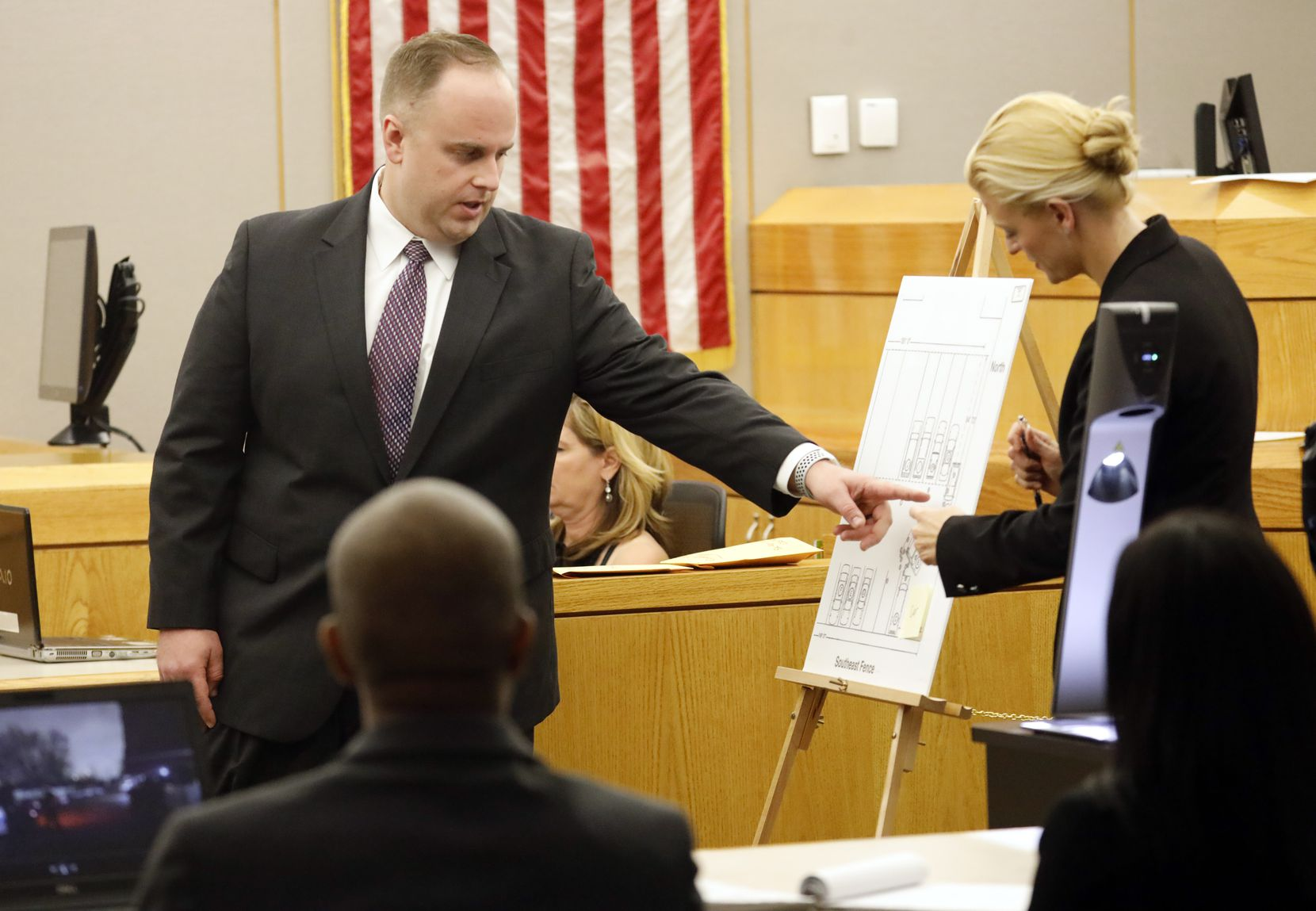 Dallas police officer Jason Kimpel, who also fired gunshots with former Dallas police officer Christopher Hess, points to a map of the scene for defense attorney Messina Madson. He was testifying in Hess' aggravated assault trial in the 292nd District Court at the Frank Crowley Courts Building in Dallas Thursday, February 6, 2020. Hess is accused of the 2017 fatal shooting of 21-year-old Genevive Dawes. (Tom Fox/The Dallas Morning News)
