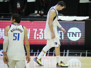 Dallas Mavericks guard Luka Doncic and center Boban Marjanovic walk off the court after a loss to the LA Clippers in Game 7 of an NBA playoff series at the Staples Center on Sunday, June 6, 2021, in Los Angeles.