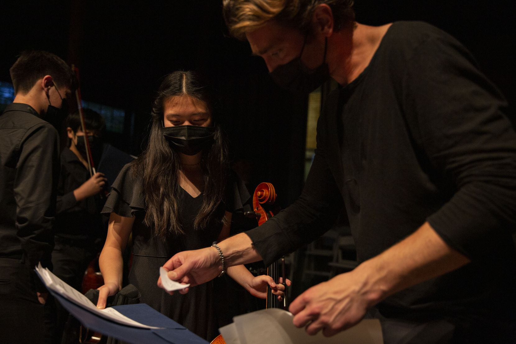 Linda Chen goes over sheet music with Texas Cellos director Joseph Kuipers.