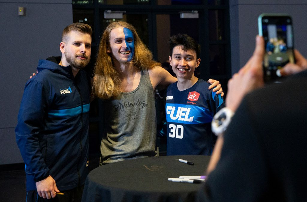 Cameron Ditzler from York, PA takes a photo with the Dallas Fuel following their 3-1 loss to the San Francisco Shock of the Overwatch League on Feb. 9, 2020 at the Esports Stadium in Arlington. The Fuel lost 3-1. (Juan Figueroa/ The Dallas Morning News)