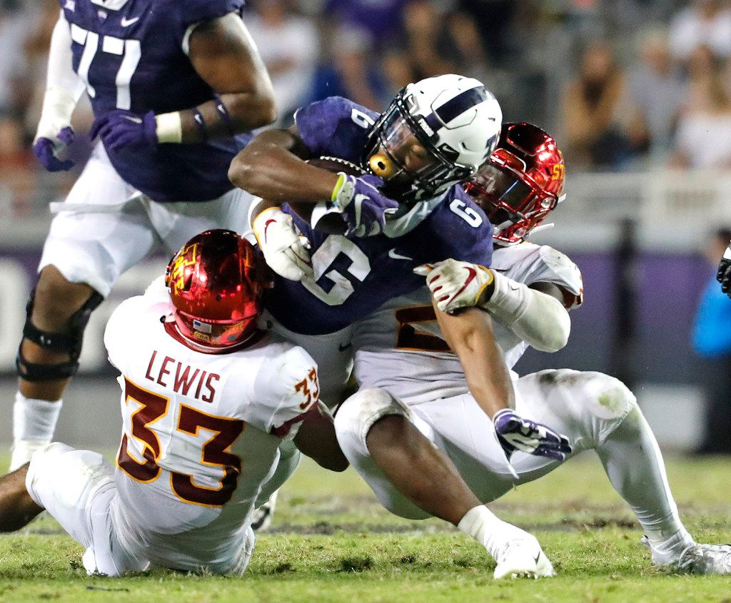 TCU running back Darius Anderson (6) is stopped by Iowa State defensive back Braxton Lewis (33) during the first half of an NCAA college football game in Fort Worth, Texas, Saturday, Sept. 29, 2018. (Bob Booth/Star-Telegram via AP)