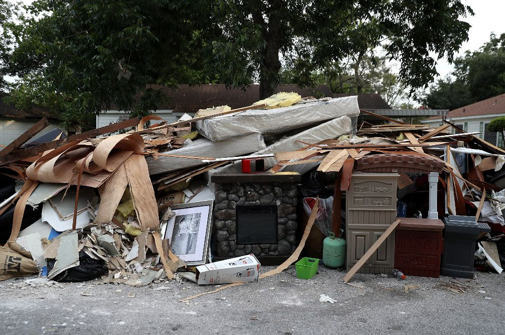 A fireplace sits in the middle of a trash pile in front of a flood damaged home on Sept. 5 in Houston. Residents are beginning the long process of recovering from floods caused by rains from Hurricane Harvey.