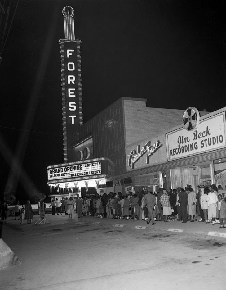 "Photo of the Forest Theater ""grand opening"" reopening in 1956. Forest Theater originally opening in 1949, but closed after several years. In 1956, it reopened, catering to an African American clientele. The Jim Beck recording Studio is visible to the right of the theater."
