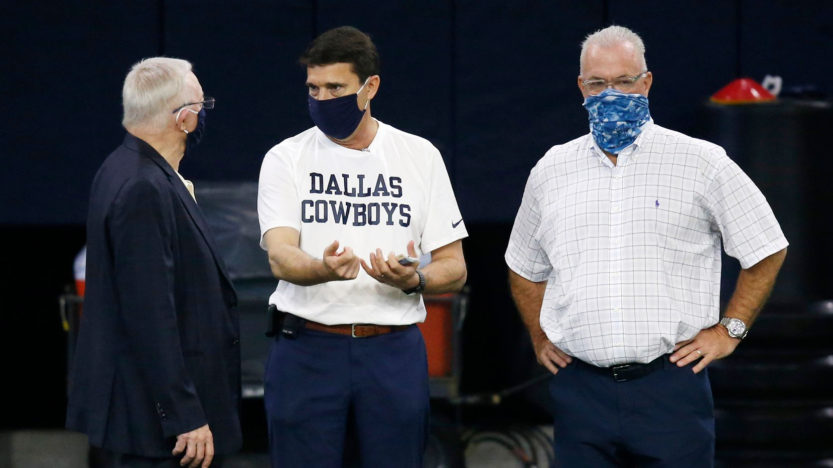 Cowboys owner and general manager Jerry Jones (left) talks with athletic trainer Jim Maurer (center) and executive vice president Stephen Jones (right) during training camp at The Star in Frisco on Monday, Aug. 24, 2020.