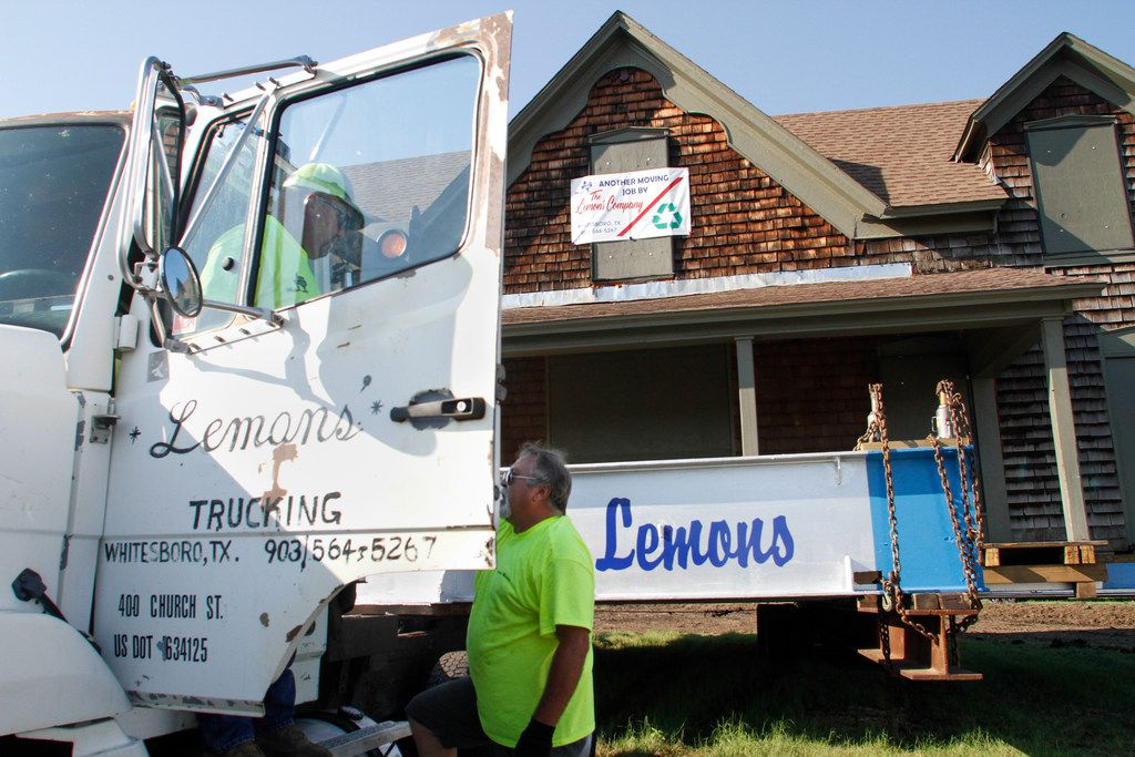Kirk Lemons and Danny Lemons of Lemons Trucking talk over the move of the Collinwood Home, built around 1861, to its new home on the Haggard farm in Plano, Tx on September 19, 2018. (Brian Elledge/The Dallas Morning News)