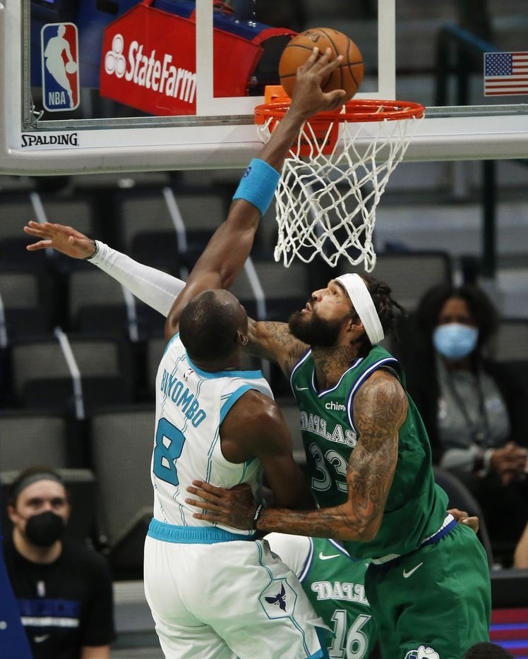 Charlotte Hornets center Bismack Biyombo (8) dunks the ball on Dallas Mavericks center Willie Cauley-Stein (33) during the second quarter of play in the home opener at American Airlines Center on Wednesday, December 30, 2020 in Dallas. (Vernon Bryant/The Dallas Morning News)