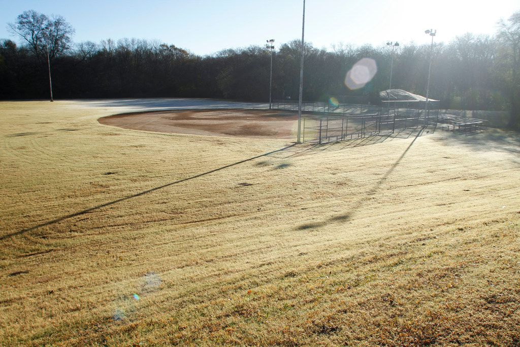 The ball field at the city's College Park next to the Lane Plating Works building.