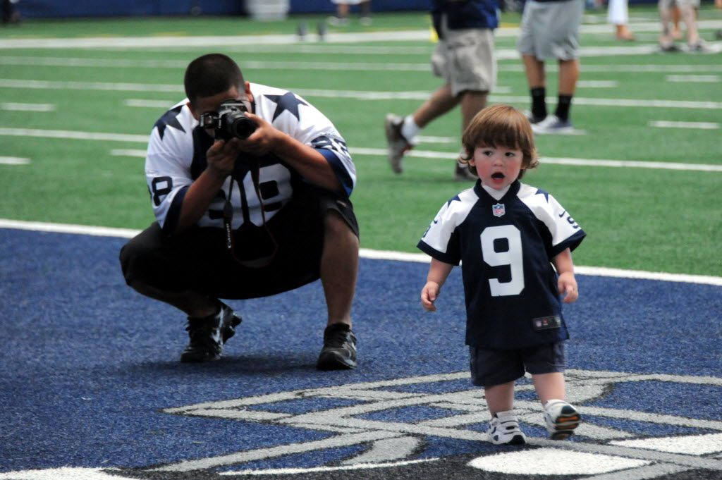 Gabriel Ortiz takes photos of his son playing in the end zone at AT&T Stadium during a Rally Days event.