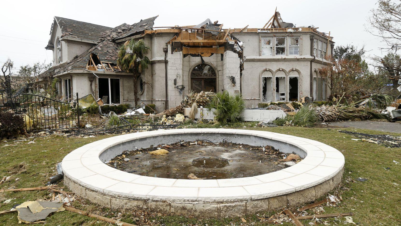 A North Dallas home near Preston Royal shopping center lies in ruins,  (Tom Fox/The Dallas Morning News)
