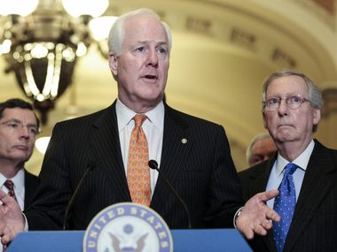 "Sen. John Cornyn, R-Texas, with Senate minority leader Mitch McConnell of Kentucky (right) and Sen. John Barrasso of Wyoming, questioned how a path to citizenship would ""solve what's broken with our immigration system."""