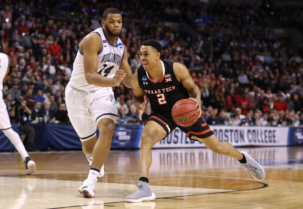BOSTON, MA - MARCH 25:  Zhaire Smith #2 of the Texas Tech Red Raiders is defended by Omari Spellman #14 of the Villanova Wildcats during the second half in the 2018 NCAA Men's Basketball Tournament East Regional at TD Garden on March 25, 2018 in Boston, Massachusetts.  (Photo by Maddie Meyer/Getty Images)