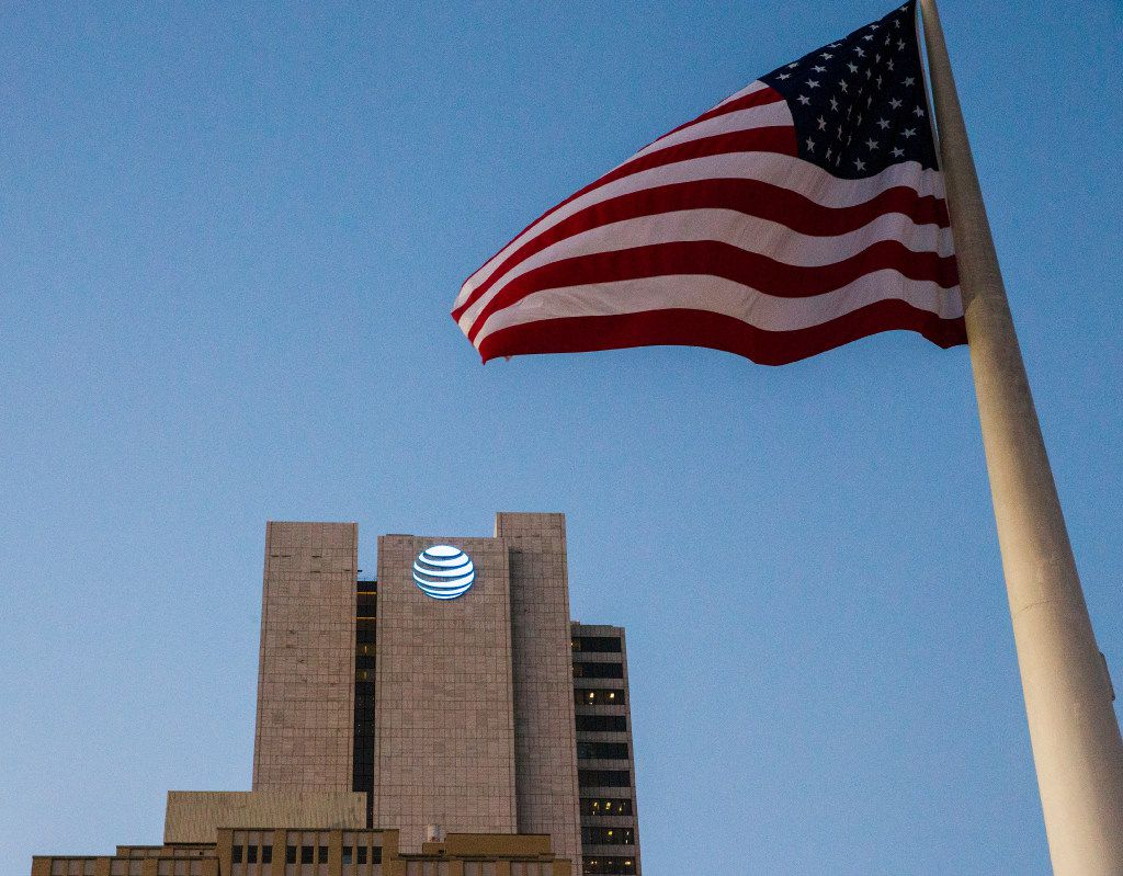 The AT&T headquarters building with the American flag that flies in front of city hall on Monday, October 24, 2016 in downtown Dallas. (Ashley Landis/The Dallas Morning News)