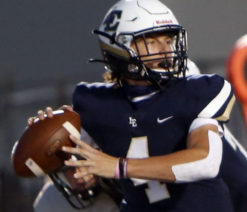 Little Elm quarterback John Mateer (4) looks to make a pass downfield during first quarter action against Plano West. The two teams played their non-district 6A football game at Lobo Stadium in Little Elm on October 9, 2020.