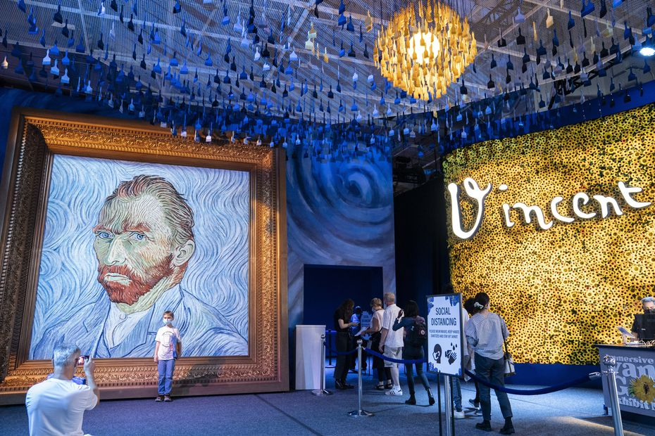 At the New York show, guests arrive beside a giant replica of celebrated painter Vincent Van Gogh's self-portrait.
