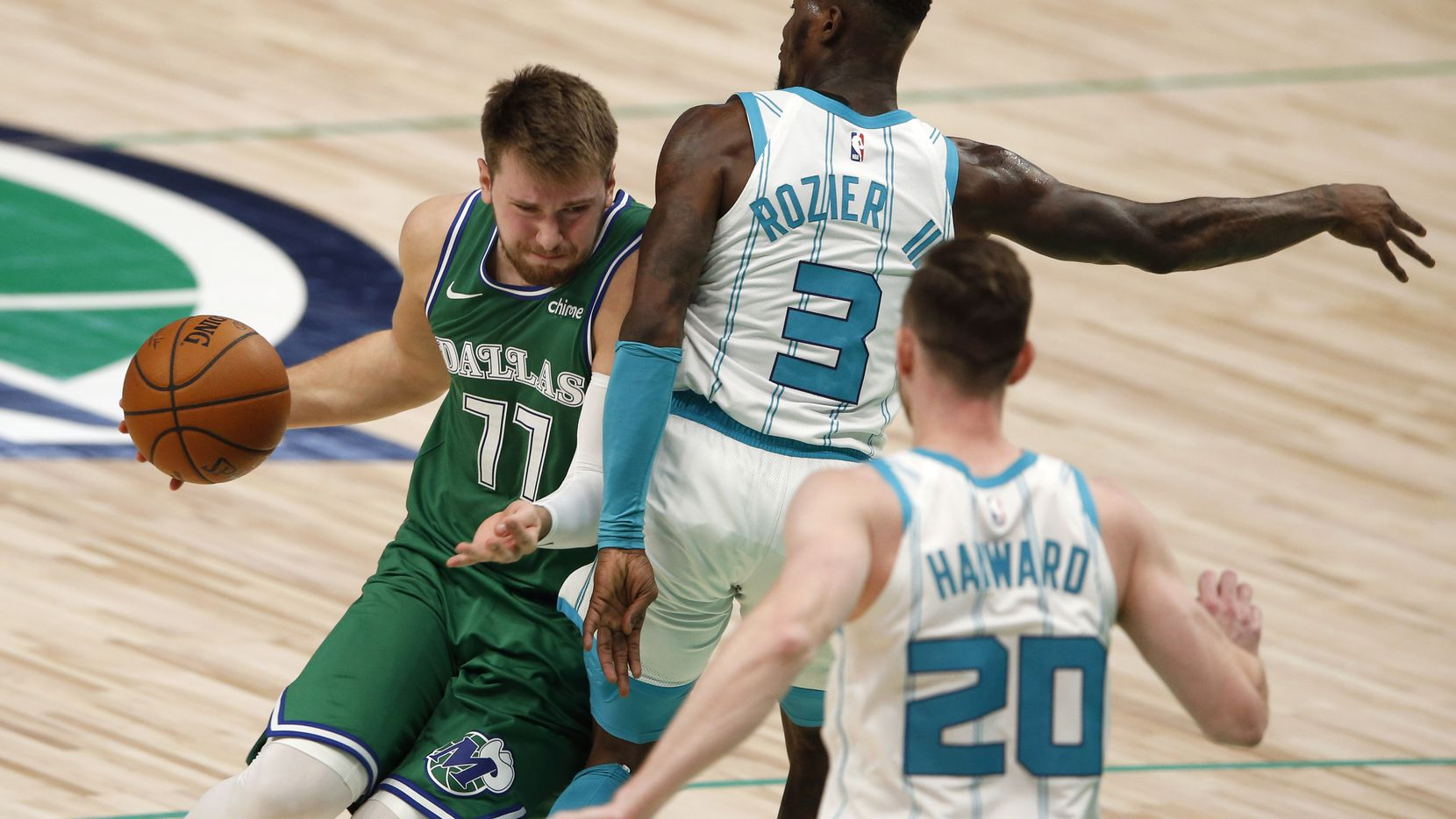Mavericks guard Luka Doncic (77) tries to get around Hornets guard Terry Rozier (3) during the third quarter of a game at American Airlines Center on Wednesday, Dec. 30, 2020, in Dallas.