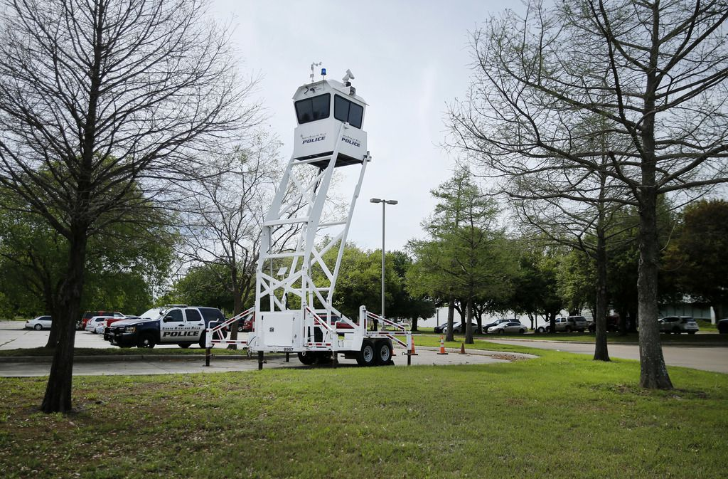 A mobile police tower and vehicle are positioned near the main entrance of Prestige Ameritech in North Richland Hills.